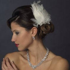 Low Bun With Feather Fascinator Hair Clip And Rhinestone Accents Paired With A Gorgeous CZ Jewellery Set~ Saved From Affordable Elegance Bridal.Com