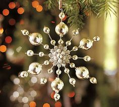 The Pottery Barn snowflake ornaments inspired her to create her own. DIY!