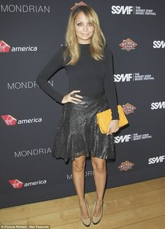 Nicole Richie in a black turtleneck   black lace skirt accessorized with a  yellow clutch bag b7aecbce95