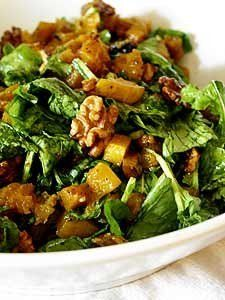 Arugula, as we said yesterday, plays well with sweet fruits and vegetables, like this roasted butternut squash. The squash's sweetness is played up with a little winter spice - nutmeg and allspice - and paired up with fresh arugula and some toasted walnuts for crunch.