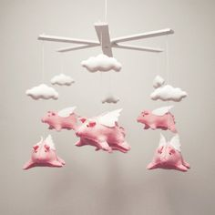 Yep.  If I ever had children guess whose going to get a pig mobile?  : ) flying pig baby mobile. hand stitched by elenicreative on Etsy, $165.00.