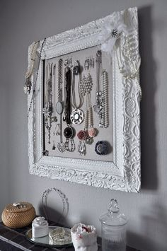 10 Seriously Creative Ways to Hang Your Jewelry - Inside an ornate picture frame | StyleCaster