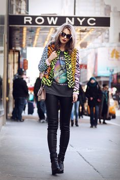 wearing a crazy moschino blazer from the barbie collection in neon color prints during New York Fashion Week | street style