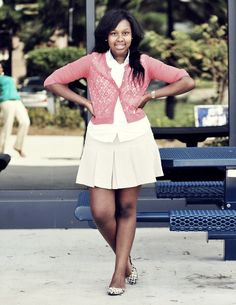 Savannah State University student is captured by photographer Cedric Smith wearing a simple pink cardigan over a white shirt and dress ensemble
