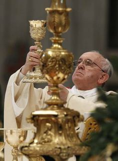 Pope Francis elevates the Eucharist as he celebrates Mass on the feast of the…