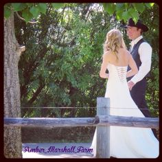 amber_marshall_farm INSTAGRAM PHOTO WEDDING WEDNESDAY! Some folks were asking to see more photos of the back of my dress. I found this one of Shawn and I walking down our lane way after the ceremony. #ambermarshallwedding #countrywedding