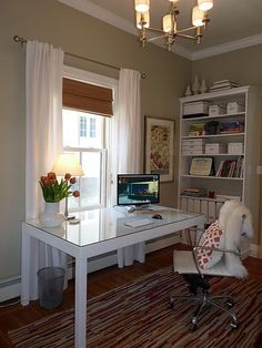 So many things I love about this room...wall color, window treatments, white furniture...