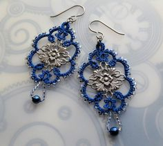 Blue filigree tatted earrings by yarnplayer on Etsy, she has patterns and books too;)