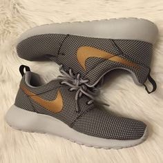 ❌SOLD❌Women's Nike Metallic Gold & Gray Roshes New, women's size 5, Nike Roshes. Gray & white material with a metallic gold Nike sign. These are so comfy & cute! Box not available. If interested, please make private offers using the offer button. [Not willing to trade.] Nike Shoes Sneakers