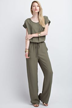 5412957f51d1 An olive short sleeve jumpsuit with cuffed short sleeves