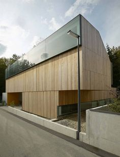 #vertical wood cladding and those #windows.Casa S/B by Bevk Perovic architects