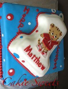 CakieSweets Daniel Tiger cake with guava & pineapple filling for a baby's 1st birthday party. Check out our other creations on our Cakie Sweets board!