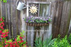 Old window frame on fence - gallery of ideas for your garden      Use this idea for the sun piece of art for the garden