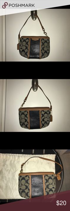 Coach Wristlet Authentic Coach authentic signature with Black and Tan leather trim wristlet. Gently used. Coach Bags Clutches & Wristlets