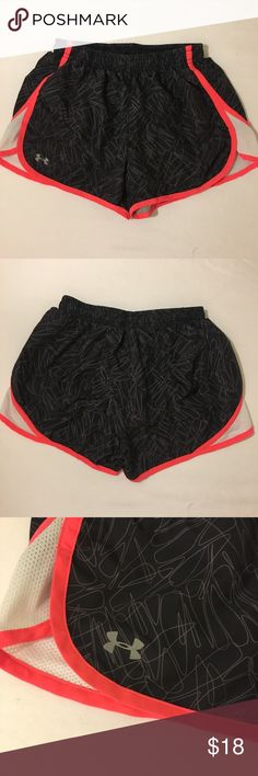 Under Armour Running Shorts Excellent condition only worn once. They have the built in brief lining. Elastic waist with a drawstring on inside and a small hidden pocket. Black with a gray zigzag design, neon pink trim, and white mess panels on the side. Feel free to ask any questions! Under Armour Shorts