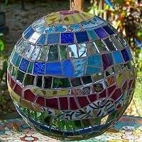 http://lagniappemosaic.com - love this art.  What if I tried using old CD's glued onto a styrofoam ball and hung if in the sun room??