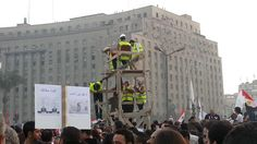 """""""Tahrir bodyguards"""" form a watchtower to keep female protesters in Egypt safe from sexual harrassment. Photo from @SarahCarr."""