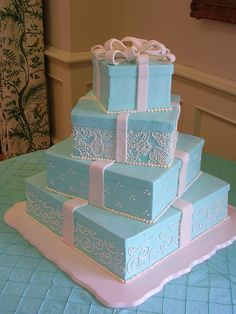 This craze came after celebs Toni Braxton and Keri Lewis had a four tier cake that was designed to look like four Tiffany's boxes, all painted robin's egg blue. Description from tiffanycake.weebly.com. I searched for this on bing.com/images