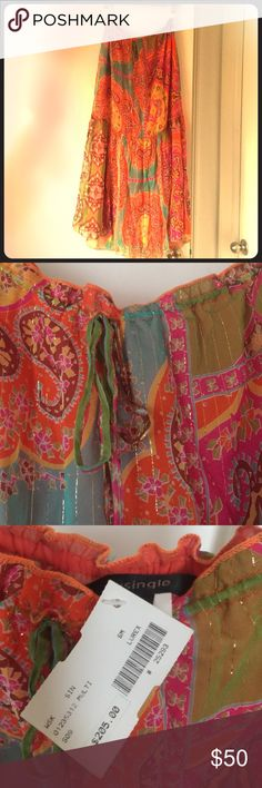 Silk skirt - multicolored. Small Silk flowy skirt - multi colored with beautiful print. There are gold flecks throughout the piece that brings out the bright colors. The fabric is so beautiful. Elastic waist with tie. Purchased at a boutique in the Hamptons. single Skirts