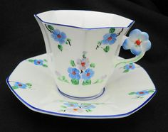 Melba china Art Deco flower handle Tea cup and saucer hand painted