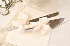 Large Satin Ribbons On The Cake Cutting Knives Photograph by Misty Miotto Photography  http://www.storyboardwedding.com/vintage-french-old-english-influence-this-lace-pearl-cypress-grove-estate-house-styled-wedding/