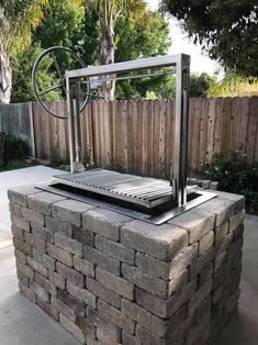 Santa Maria grill in a masonry enclosure. Would like something like this but could also do a Santa Maria grill on casters (they sell them with and without) Outdoor Kitchen Patio, Outdoor Kitchen Countertops, Outdoor Kitchen Design, Outdoor Living, Kitchen Wood, Santa Maria Grill, Brick Bbq, Brick Built Bbq, Wood Charcoal