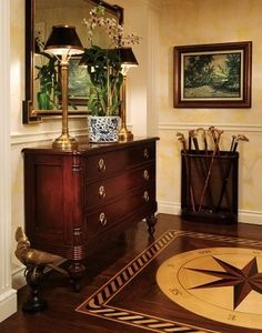 Great traditional area with a masculine feel.The compass rose in the floor is outstanding. Black adds a sophisticated touch.I would prefer the art to be narrower than the cane stand underneath it though- would look more balanced.