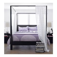 Pavillion Black Canopy Bed | Crate and Barrel  Pavillion makes a sophisticated sleep statement in solid mahogany and mahogany veneer with a black lacquer finish. Dramatically tapered posts support canopy rails that lend themselves to romantic draping.