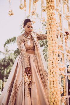 Beautiful beige lehenga with gold blouse with white and gendaphool flowers décor |WedMeGood| Karishma & Sean|#wedmegood #indianweddings #gold #lehenga #floraldecor #gendaphool #white #decor #simple