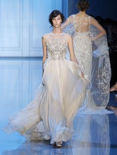 From Haute Couture Fall 2011 Collection by Elie Saab: Full-length chiffon gown, quartz colour, chest embroidered with swarovski crystals, transparent boat neck. Swoon.