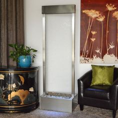 Elegantly understated, the 6' Gardenfall Clear Glass and Brushed Stainless Steel Floor Fountain with LED Lights combines stainless steel with clear glass to ach