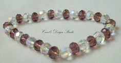 Beautiful clear and amethyst colored crystals make this a beautiful bracelet. #handmade #etsyretwt