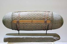 Deloss Webber  reclining  granite,sandstone, bamboo, rattan  15x28x10