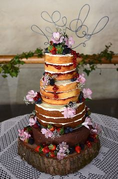 wedding cake with different layers and no frosting. Not sure about this but a different idea