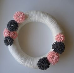 I can make my own version with flowers in pink and green...    White, Pink, Gray Yarn Wreath, Any season. $26.00, via Etsy.