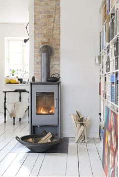 Wonderful wood burning stove in Copenhagen. I have a hearth for a stove in the family room, this one is cool Modernisme, Home Fireplace, Small Fireplace, Log Burner, Scandinavian Style, Scandinavian Fireplace, Home Fashion, Home And Living, Living Rooms