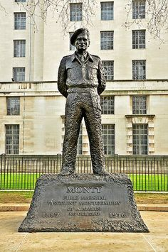 """Monty's statue stands in Whitehall, outside the MOD & was unveiled by Queen Elizabeth, the Queen Mother - 6.6.1980. FM Bernard Law Montgomery, 1st Viscount Montgomery of Alamein, KG, GCB, DSO, PC (17.11.1887 – 24.3.1976), nicknamed """"Monty"""" and the """"Spartan General"""" was a British Army officer. Saw action in WWI & seriously wounded. During WWII he commanded the 8th Army from August 1942 in the Western Desert until the final Allied victory in Tunisia. This command included the Battle of El…"""