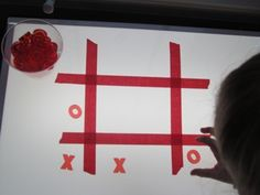 Tic tac toe on light table - could be a Valentine's themed activity too!
