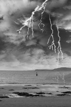 """The image this week, is called """" fisherman fishing in a thunder storm """" Taken in Ballybunion, county Kerry on the west coast of Ireland on the beautiful Wild Atlantic Way . To see more images like this go to www.morrbyte.com West Coast Of Ireland, More Images, Donegal, Thunderstorms, Northern Ireland, Dublin, Waves, Clouds, Beach"""