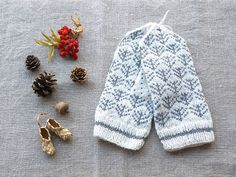 Knitted white gray mittens