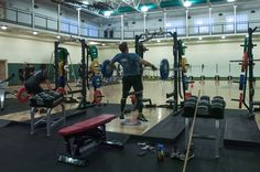A soldier assigned to the 7th Special Forces Group (Airborne) performs an Olympic Lift in the Group's Combat Readiness Training Facility. The soldier is performing the Olympic Weightlifting exercise called the snatch. Olympic Weightlifting develops explosive strength through the hips, legs, and upper body. The CRTF is an integral part of the Group's Human Performance Program, an initiative combining the expertise of strength and conditioning coaches....