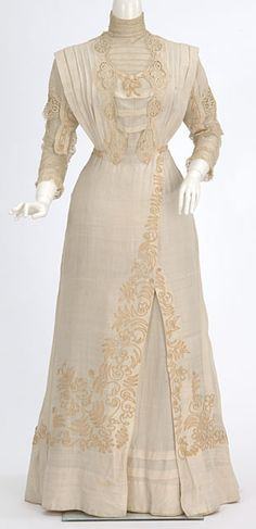 Eggshell color silk dress trimmed with lace and braid. Made by dressmaker Mary Abigail Molloy, St. Paul, Minnesota.
