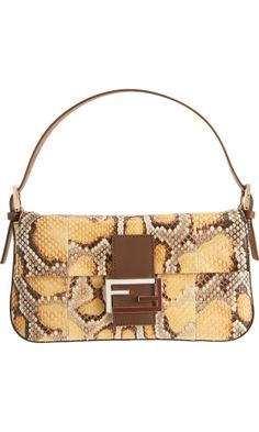 5bbe19c34735 Fendi Baguettes are making a comeback! Not quite as bling as baguettes  past