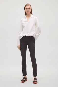 Designed with matte black ankle zips, these slim-fit trousers are made from stretchy cotton twill. Cut to sit on the waist, they have a simple back pocket, elastic waist and a hidden zip-up fastening at the side. Inside leg length of size 6 is Cos Trousers, Slim Fit Trousers, Trousers Women, Pants For Women, Kermit, Business Outfits, Outfit Goals, Minimalist Fashion, Black Pants