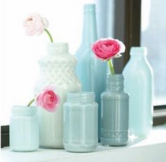 The Project: Blue Bottle Display The Essentials: Clear glass bottles and jars, paint in an assortment of monochromatic colors (acrylic is not ideal). Skill Level: Beginner The Tricky Part: Finding the perfect shades of paint. Further Reading: Poppytalk Painting Glass Jars, Painted Glass Bottles, Painted Vases, Bottle Painting, Bottles And Jars, Diy Painting, Mason Jars, Empty Bottles, Decorated Bottles