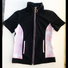 Authentic Christian Dior Zipper Logo Top Size M Authentic Christian Dior Boutique Black Cotten blend zipper front top with the most wonderful pink and ivory logo panels and both zipper and pocket detailing. In good used condition with no stains or flaws to note other then some minor pilling under the collar.  Size Medium. Extremely rare and hard to find. No PayPal and No Trades. Merci! Christian Dior Boutique Tops