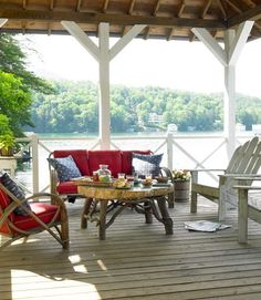house on the lake. Love the white pergola w/wood top. Red accents a must