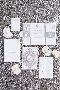 Heidi + Sam | White orchids and cream roses filled the Four Seasons Hotel Toronto.  We love the Art Deco-styled invitation suite! | Photography by: Visual Cravings