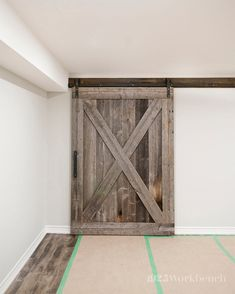 A large custom door on our Heavy Metal barn door hardware for a basement Reno. All made in Canada by 1925Workbench