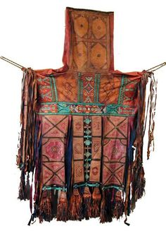 A leather bag with intricate leatherwork and beading that is probably used during their long treks across the desert. Taureg